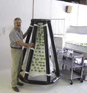 The president of Agrihouse next to an inflatable plant system