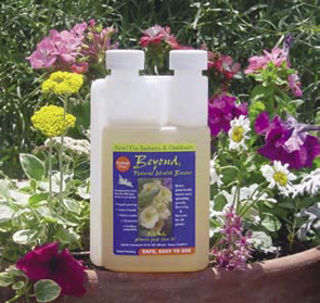 A bottle of the Beyond all natural plant booster in front of wildflowers